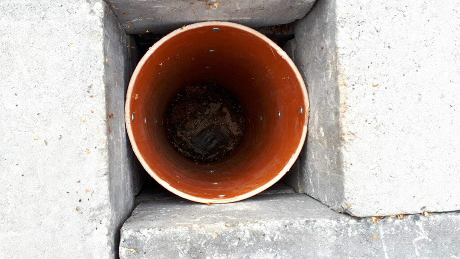 Rohr in Eckquader Feuerstelle